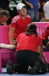 Justine_injured_fed_cup